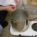 Preparing and boiling materials to get them ready for pulping.